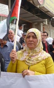 Palæstinensisk kvinde demonstrerer