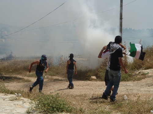 Fields are set on fire by tear gas
