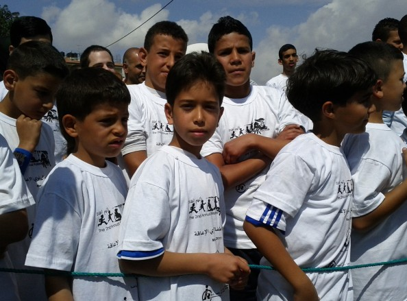 Children get ready at the 5k race in Ramallah