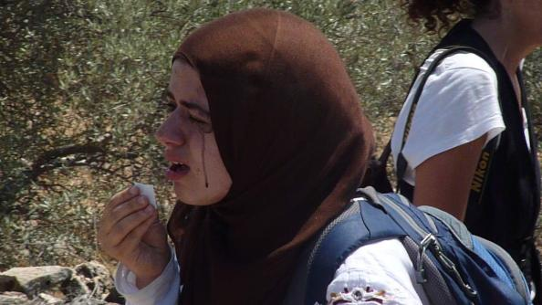 Girl crying from tear gas at Bil'in demonstration