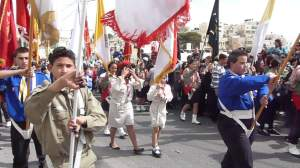 Palestinian scouts lead procession on Mt of Olives Palm Sunday