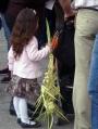 Palestinian girl with braided palm leaf