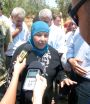 Palestinian woman in Beitala talks to journalists